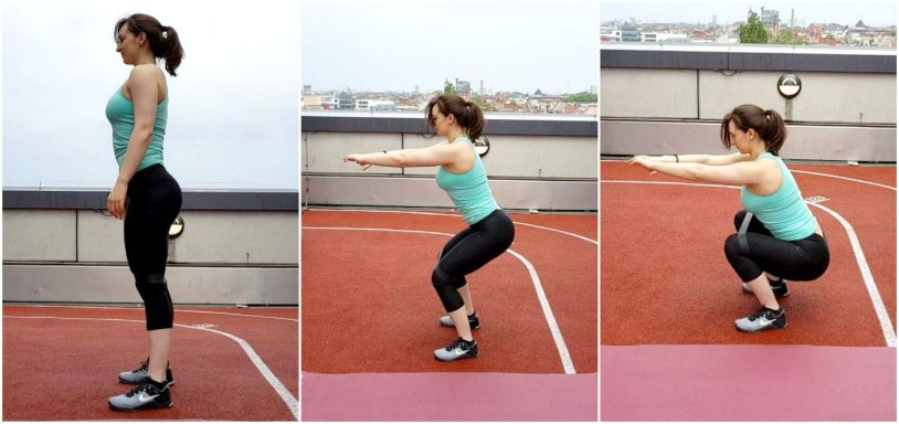 """Fir girl squats with a resistance band from the article """"bodyweight glutes and legs building workout"""""""