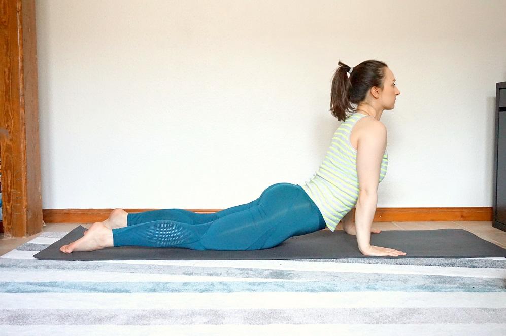 Girl demonstrating the Upward facing dog yoga pose