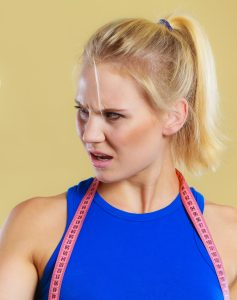 Frustrated angry blonde girl from article absurd gym advice by men