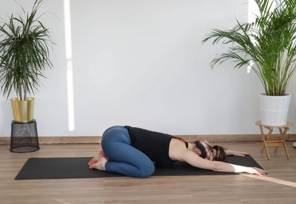 child's pose demonstration from article 8 must-do cooldown mobility exercises