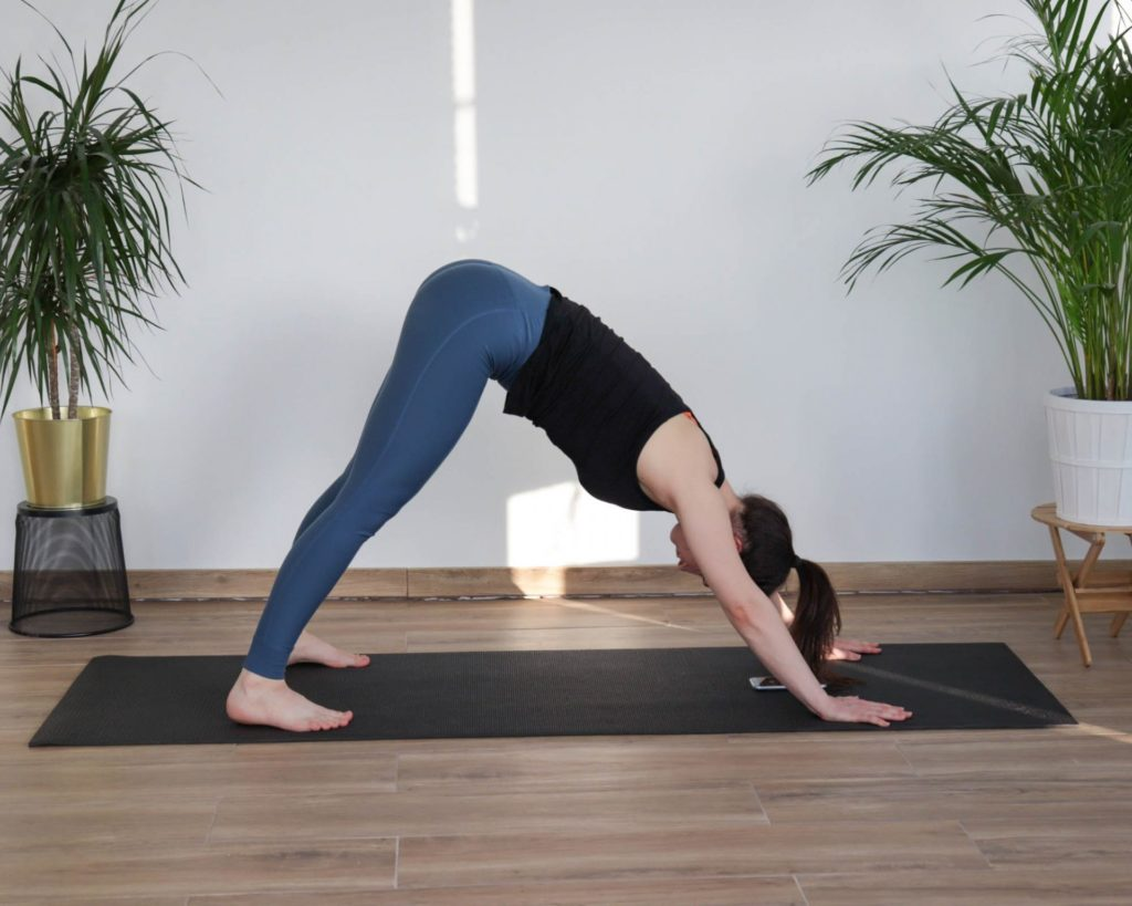 downward facing dog yoga pose from article 8 must-do cooldown mobility exercises
