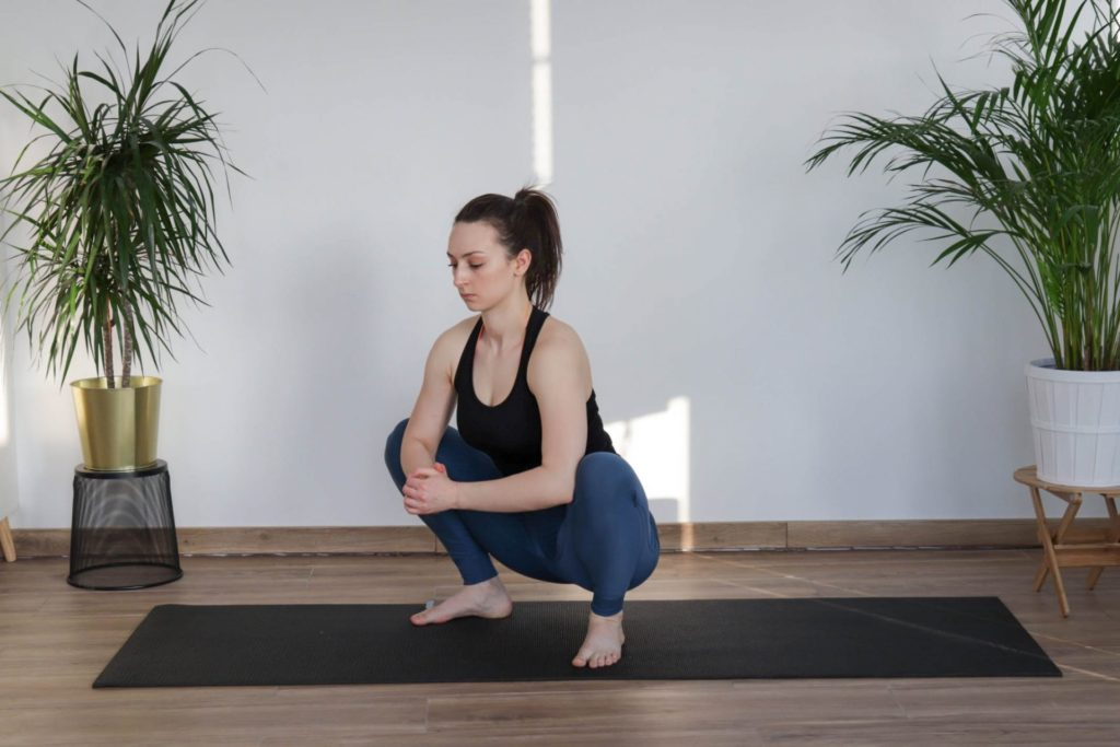 Deep Squat Stretch from article 8 must-do cooldown mobility exercises