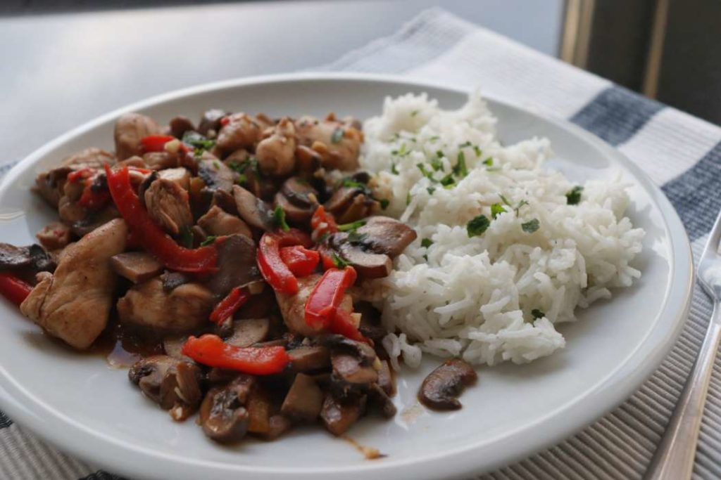 Healthy dish of chicken with veggies and rice made from healthy food staples