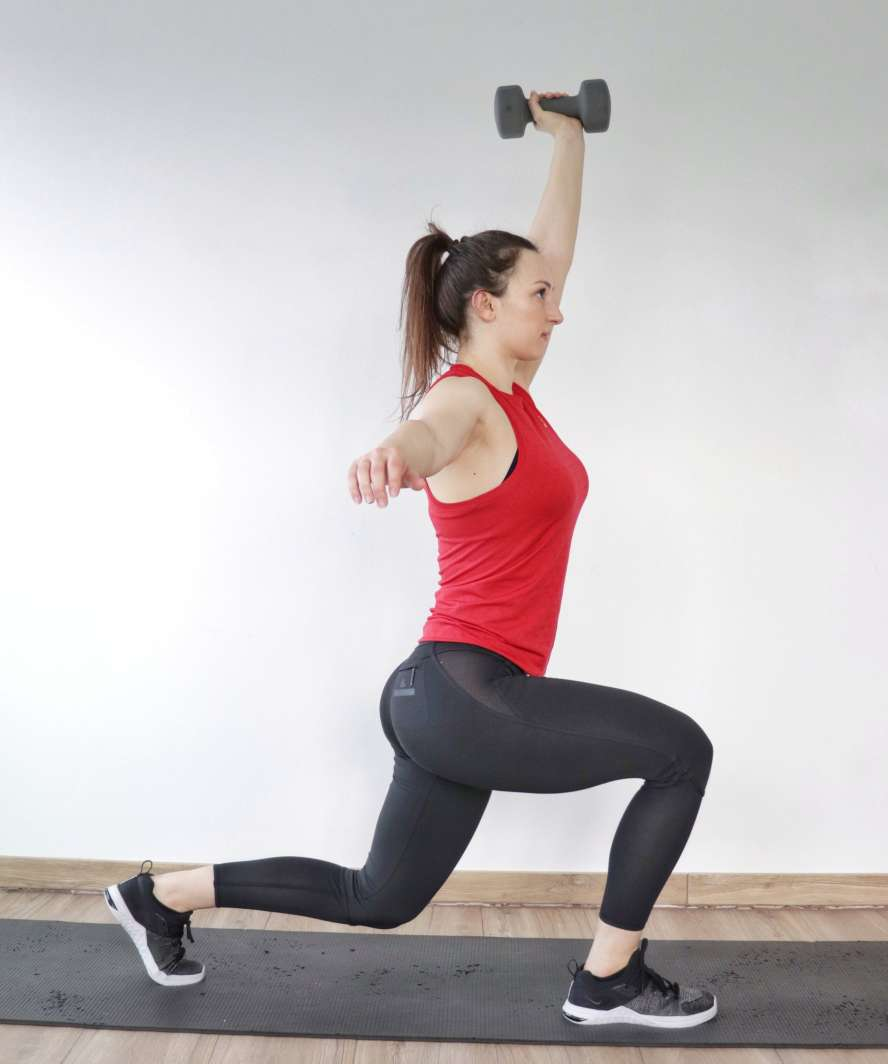 Lunge with press as part of strength and hiit workout for women