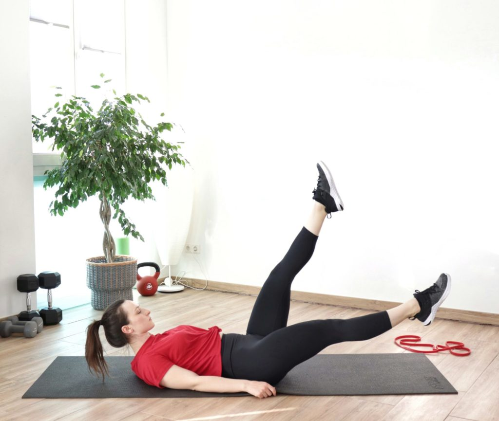 Bodyweight scissors exercise part of a full-body bodyweight workout