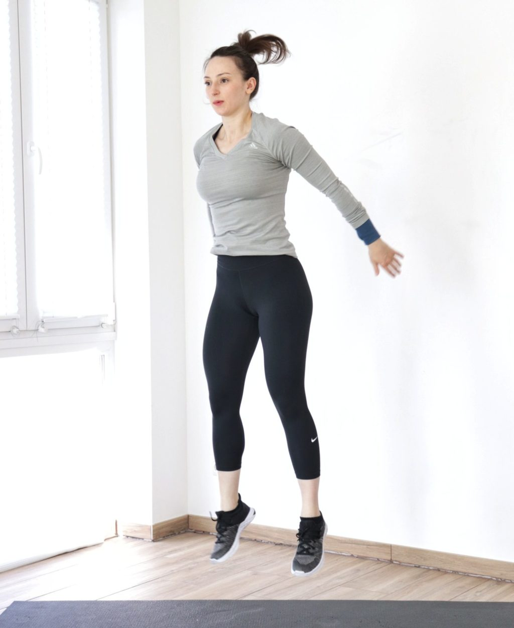 girl jumping up while exercising