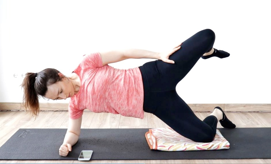 side-lying hip raise exercise