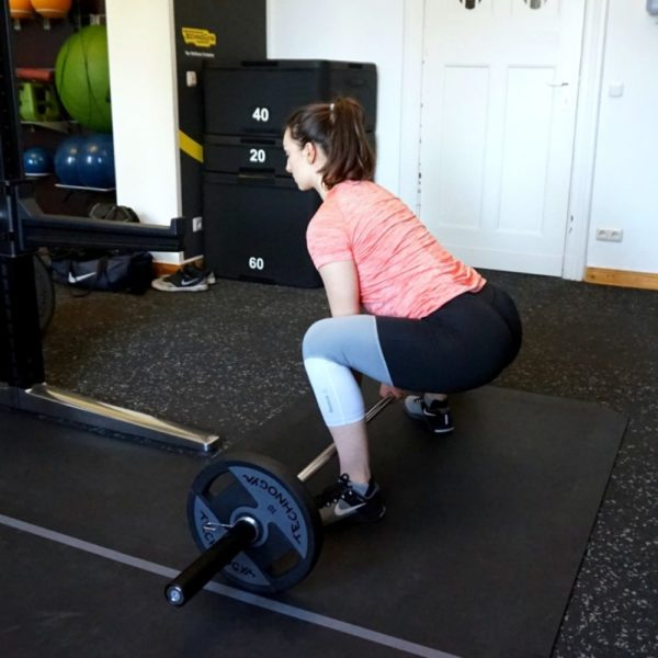 """image of a young woman demonstrating the deadlift from the article """"Top 8 Glute Exercises to Build and Shape your a strong Ass"""""""
