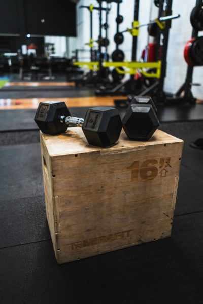 image of dumbbells on a box from the article Home Gym Equipment pieces you need